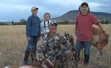 Owner JT Nunn with his 2011 antelope. 36 yard shot with his Mathews bow. Also pictured are his two sons Colter and Garrett (middle and right) and their friend Justin (left). The boys watched the hunt take place from a few hundred yards away.