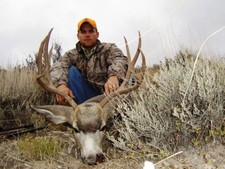 Chad Justus shown here with a nice mule deer buck taken during the early October deer season.