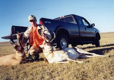 Our 2002 antelope hunts were a great success.  This hunter poses with both his and his buddies trophy pronghorn.