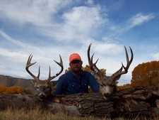Ty Jarvis pictured here with two nice deer taken during the fall 2006 hunting season.  The whitetail on the left was taken along the Laramie River, while the mule deer was taken few miles south of the ranch headquarters.