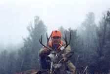 Mark Nethery from KY shown here with his trophy 4x4 mule deer buck.