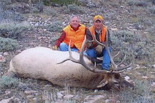 Tom Gebbie shown here with his 2004 bull elk.  Bigger than the year before...we'll see what happens in 2005 as Tom plans to return again and try his luck at another Wyoming elk hunt.