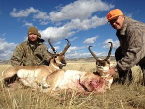 <p>Stan &amp; Greg together with their rifle antelope</p>