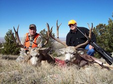 Ed O. and John H. show off their 2006 trophy mule deer bucks.  Both of these bucks were taken during the mid October deer hunting season.