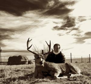 <p>Mark with his 2013 Wyoming Mule Deer. Mark also took a very nice <a href=